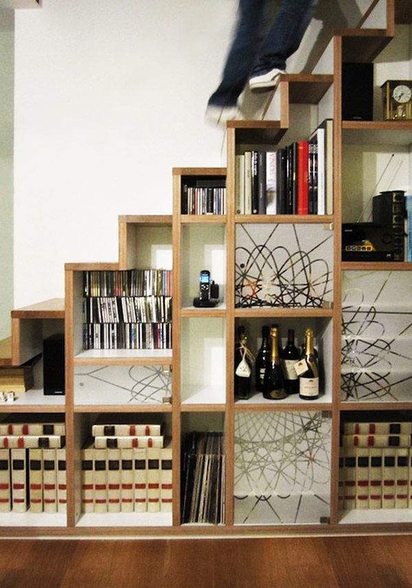 small-bedroom-bookshelf-decorated-shelves-hidden-away-by-the-stairs-for-home-interior-design-ideas